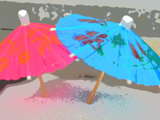 Sonnenschirm und Sandstrand - der perfekte Sommer!