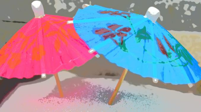 Sonnenschirm und Sandstrand - der perfekte Sommer !